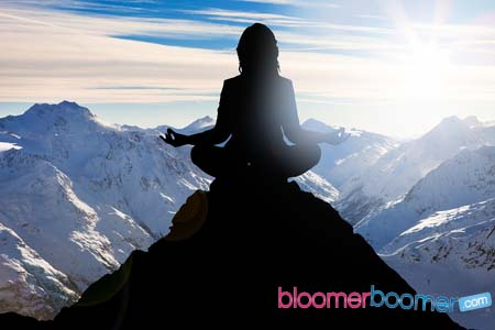 56706558 - silhouette of a woman performing yoga on mountain peak